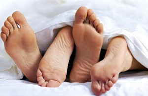 couple's feet on bed