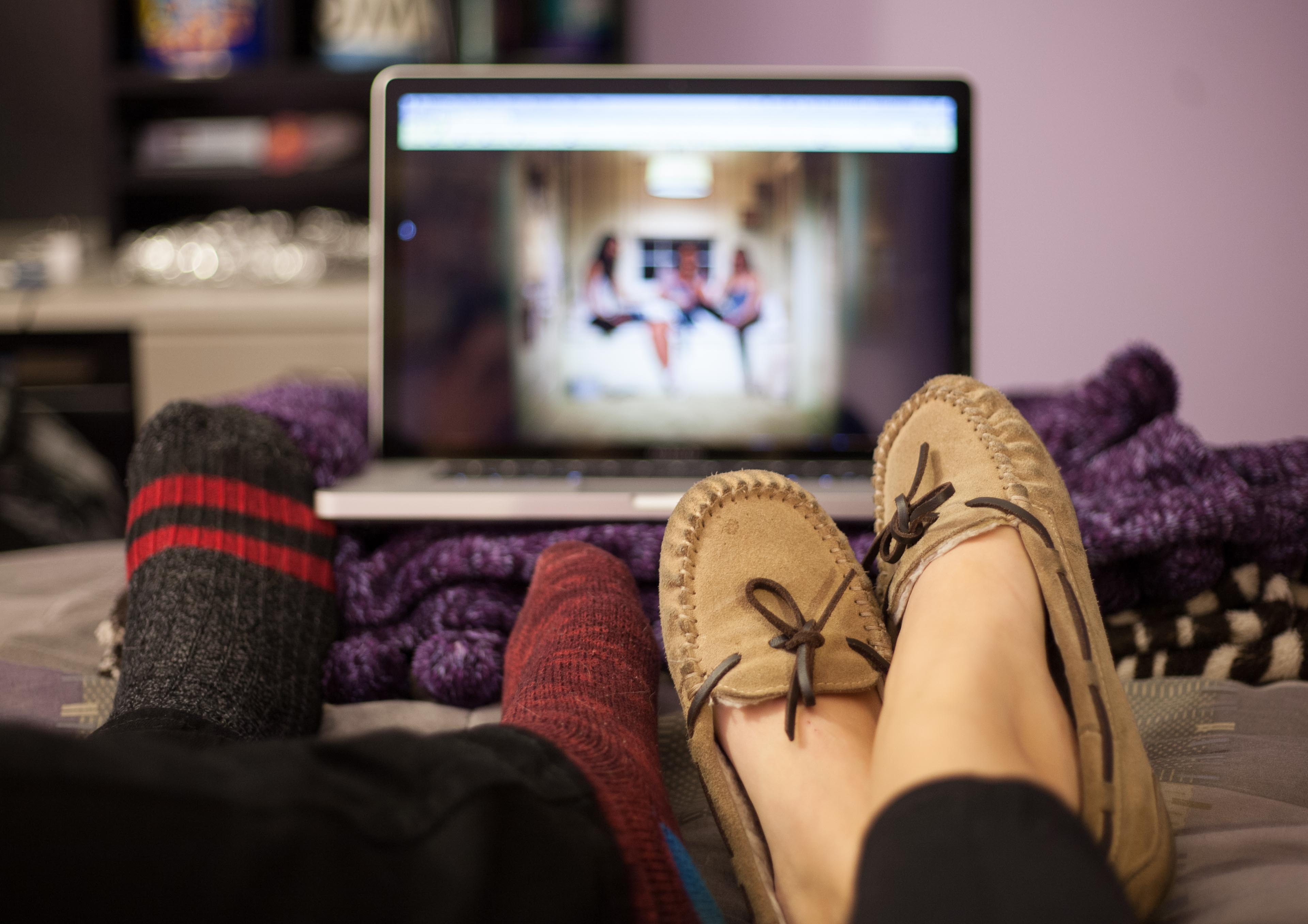 couples feet watching movie