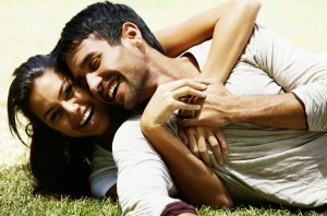 couple hugging on grass