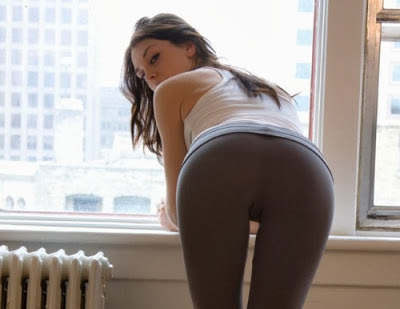 sexy lady leaning on the window