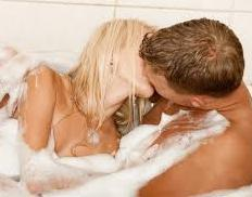 couple kissing in a tub